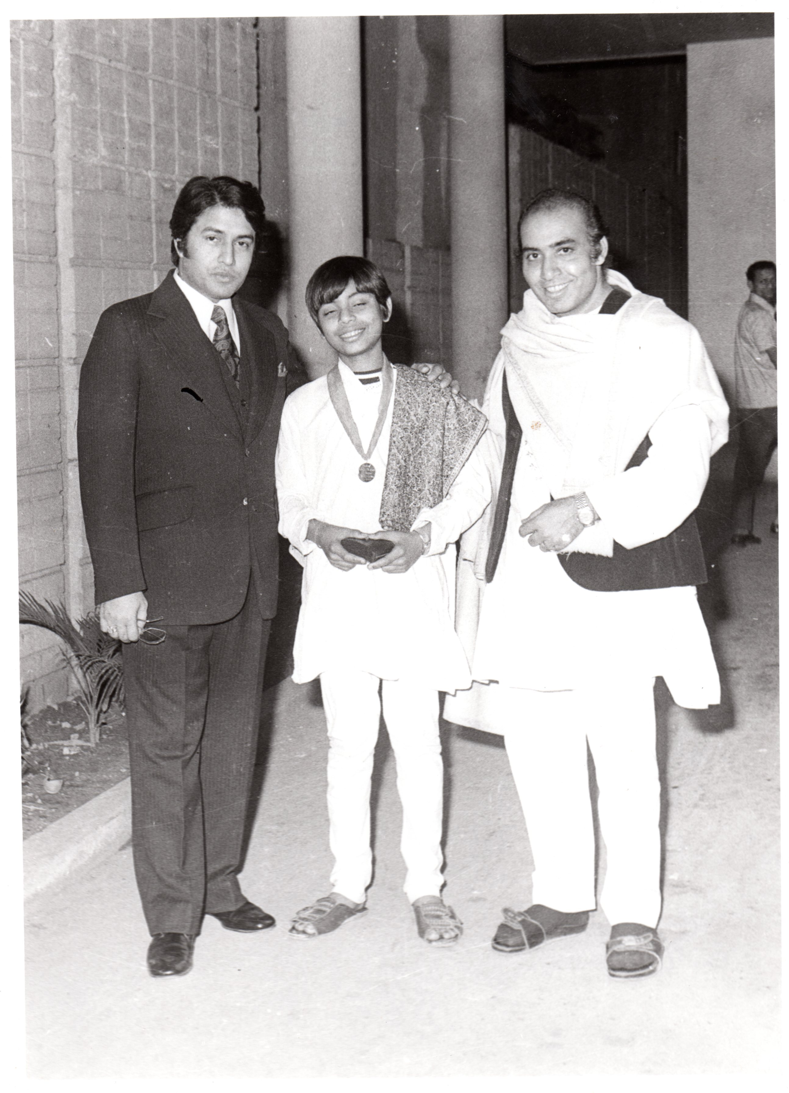 1973 with father receiving gold medal from Ustad Amjad Ali Khan